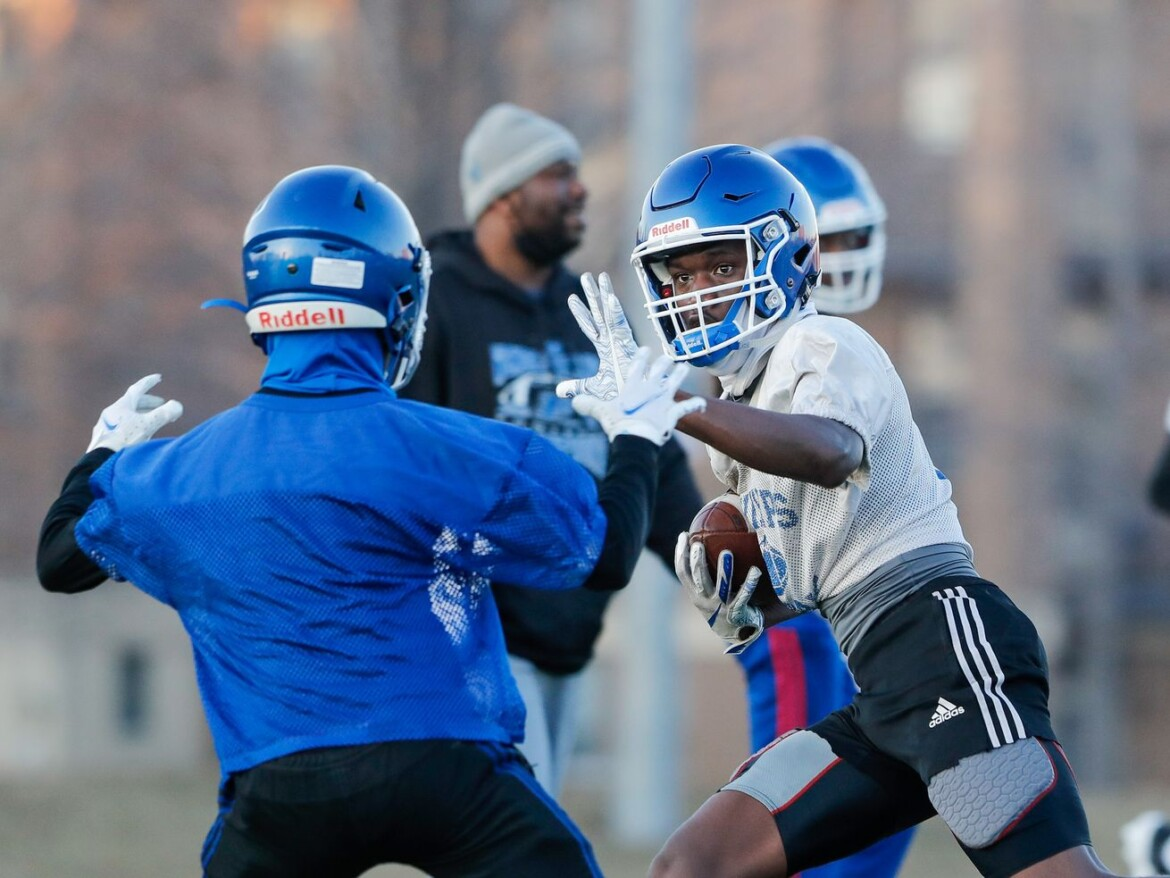 Emotional Phillips starts football practice missing Mike Larson