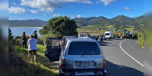 GREAT BARRIER ISLAND, NEW ZEALAND: Residents wait on higher ground following a tsunami warning on March 5, 2021 in Great Barrier Island, New Zealand. A number of low-lying coastal areas were evacuated across New Zealand following a series of earthquakes this morning. While the threat level has now been downgraded, wave surges are still expected along coastal areas, with New Zealanders warned to stay off beaches. (Photo by Bridget Cameron)