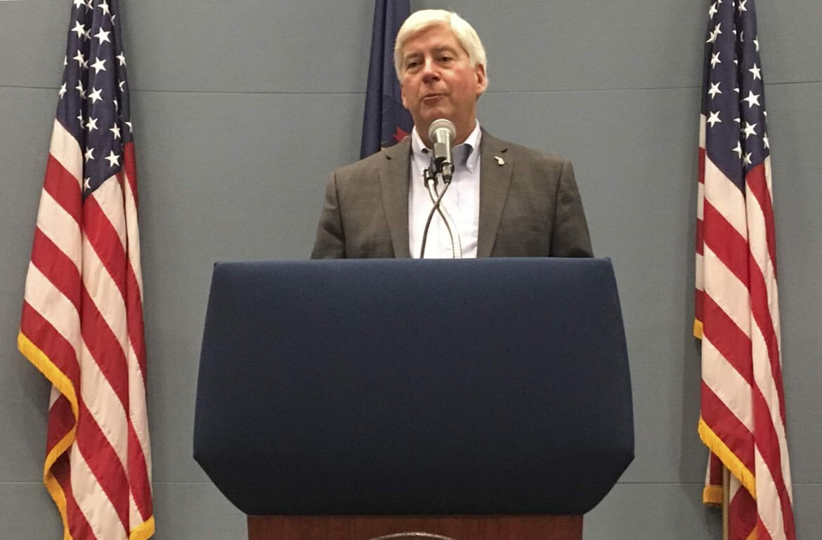 Michigan ex-governor loses challenge to Flint water charges
