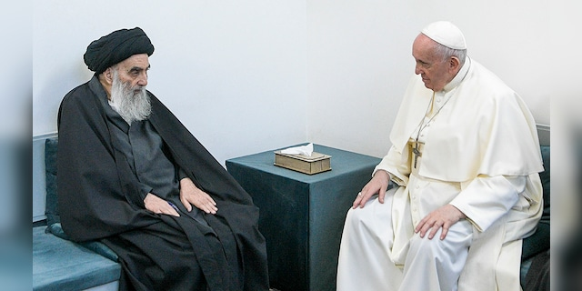 Pope Francis, right, meets with Iraq's leading Shiite cleric, Grand Ayatollah Ali al-Sistani in Najaf, Iraq, Saturday, March 6, 2021. (Associated Press)