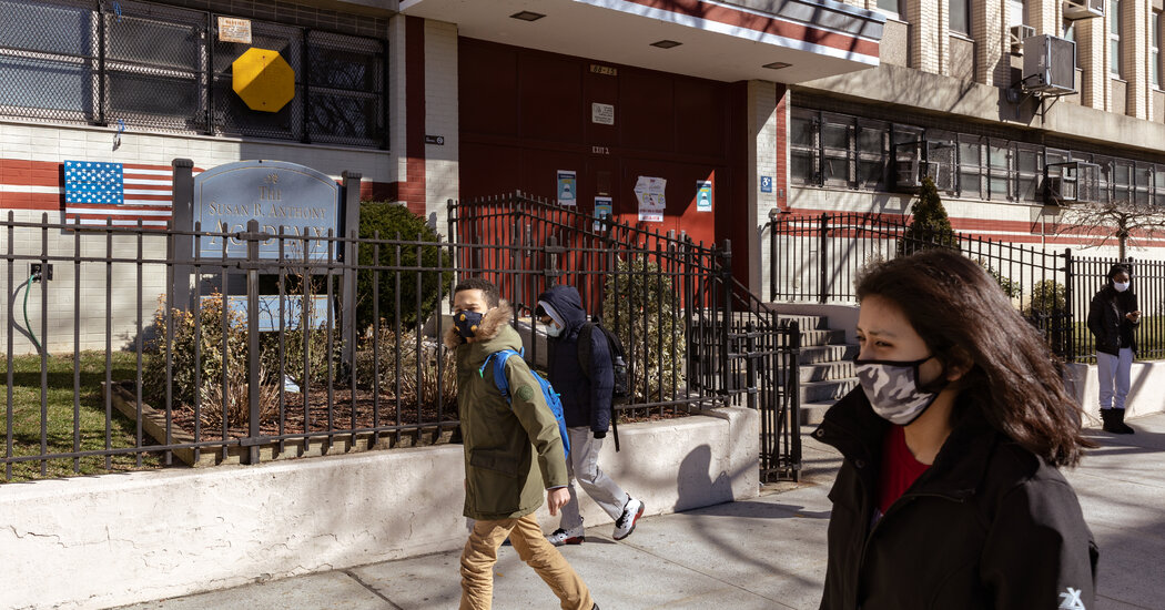 N.Y.C.'s mayor says a new virus rule will reduce temporary public school closures.