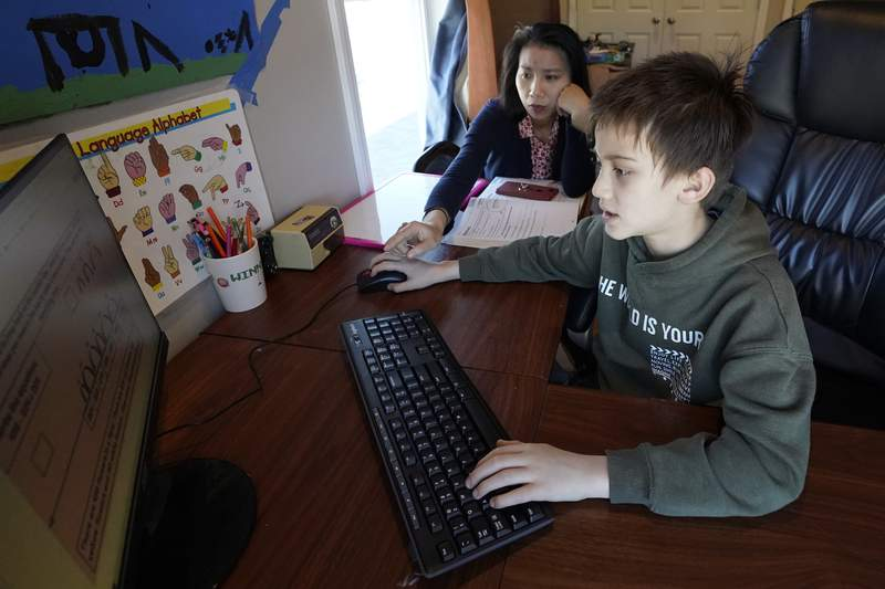 Asian Americans wary about school amid virus, violence