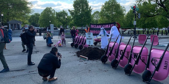 Left-wing group dumps cow poop at White House entrance, demands Biden take climate action