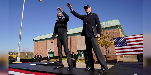 FILE - Biden and Obama wave to the audience at a rally at Northwestern High School in Flint, Mich., Saturday, Oct. 31, 2020. (AP Photo/Andrew Harnik)