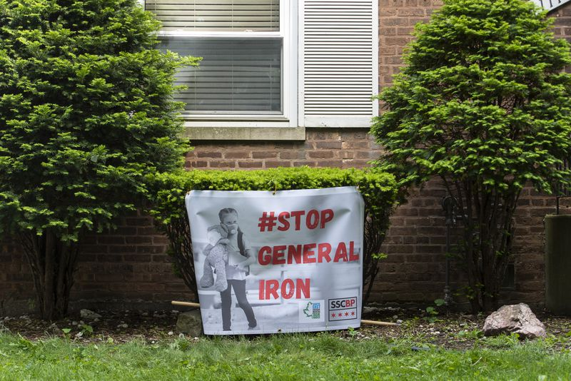 A stop General Iron sign sits in front of Gina Ramirez's home in the southeast side of Chicago, Thursday, May 28, 2020. Ramirez like many others in her neighborhood are concerned about General Iron wanting to open a new metal shredding plant near where she lives. | Tyler LaRiviere/Sun-Times