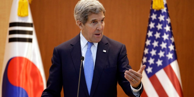 John Kerry says US and China's 'differences on human rights' shouldn't get in way of fighting climate change