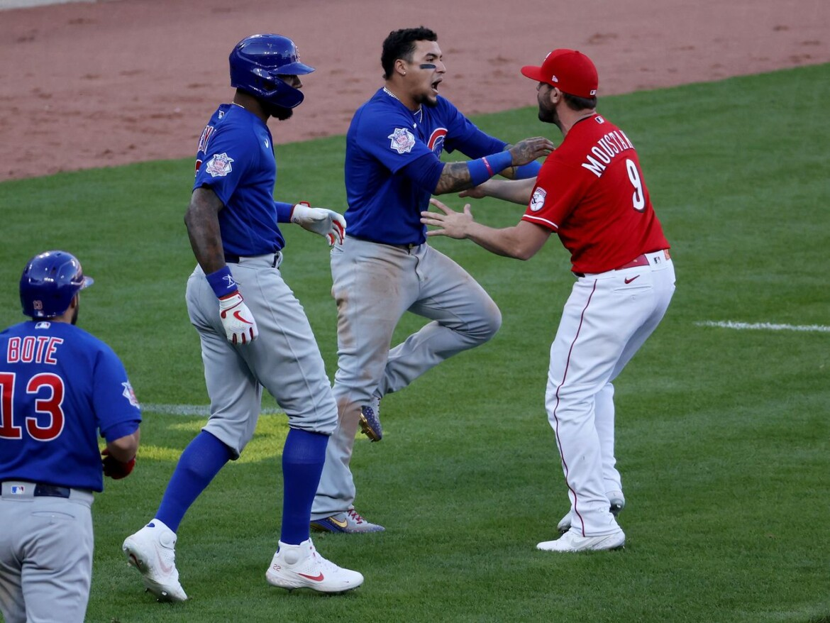 Emotions run high in Cubs' 3-2 comeback victory over the Reds as benches clear