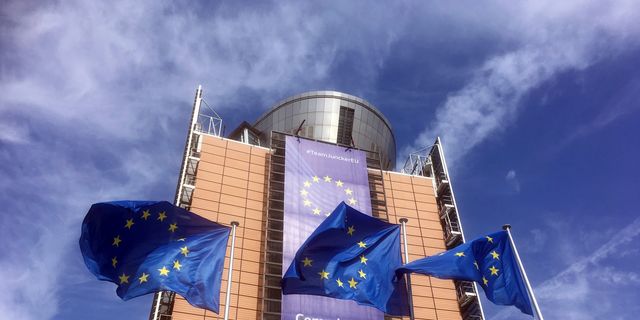 European Union flags flap in the wind outside EU headquarters in Brussels, Wednesday, April 10, 2019. (AP Photo/Virginia Mayo)