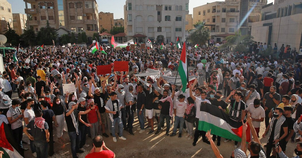 Protesters in Jordan march to the Israeli border in support of Palestinians.