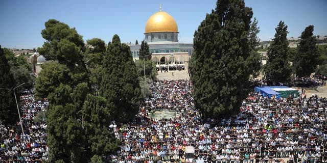 Worshippers take part in the last Friday prayers of the Muslim holy month of Ramadan at the Dome of the Rock Mosque in the Al Aqsa Mosque compound in the Old City of Jerusalem Friday.