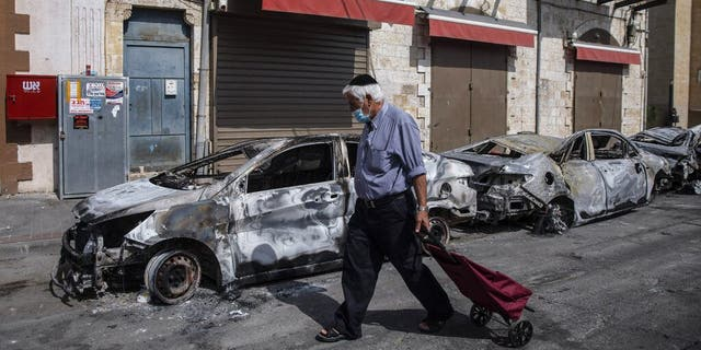 Riots erupt in parts of Israel as tensions flare