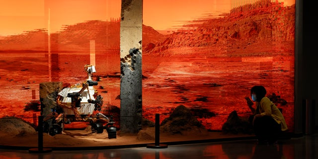 China says it has landed its first probe on Mars