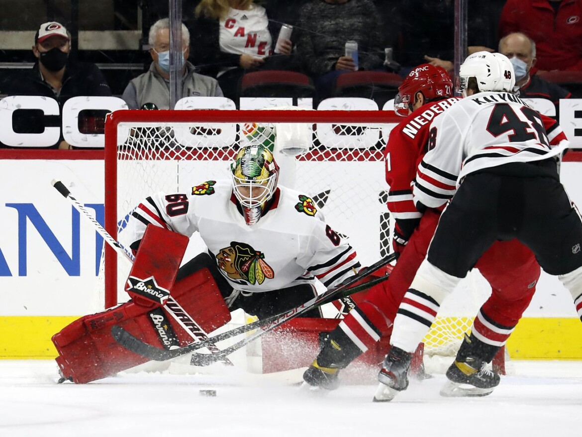 Blackhawks crumble against Hurricanes after Collin Delia finally earns a start