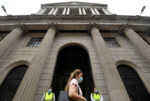 Bank of England sees faster economic rebound, slows its bond buying