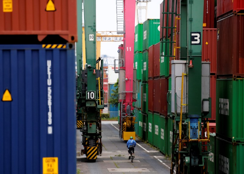 Japan exports jump, machine orders up in sign of recovery