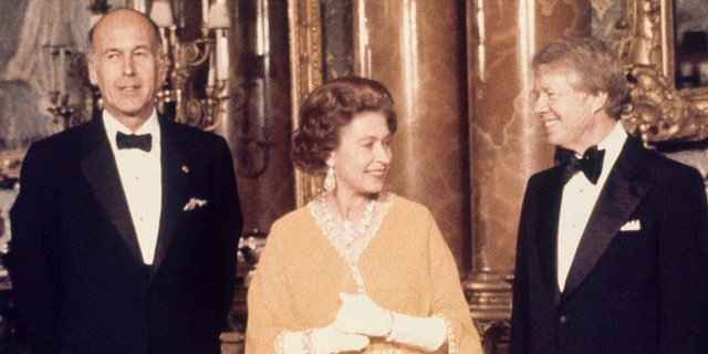 In this file photo dated May 1977, U.S. President Jimmy Carter, right, and Queen Elizabeth II stand with French President Valery Giscard d'Estaing at Buckingham Palace in London. (AP Photo, File)
