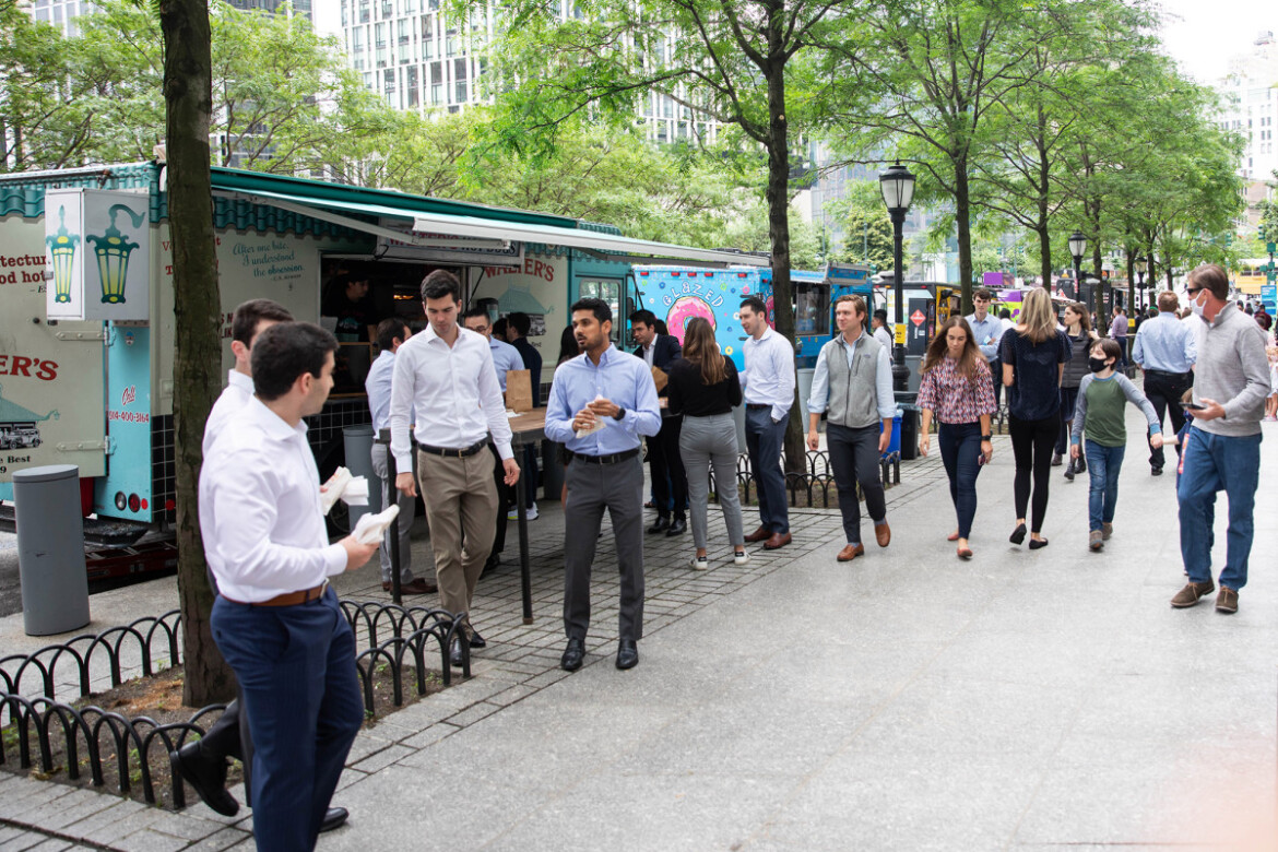 Goldman Sachs welcomes bankers back to the office with live music, food trucks
