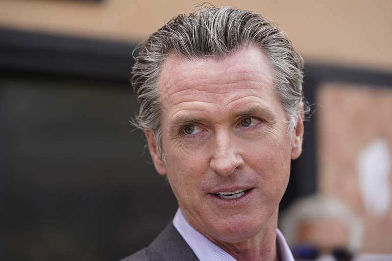 California governor signs orders to roll back virus rules