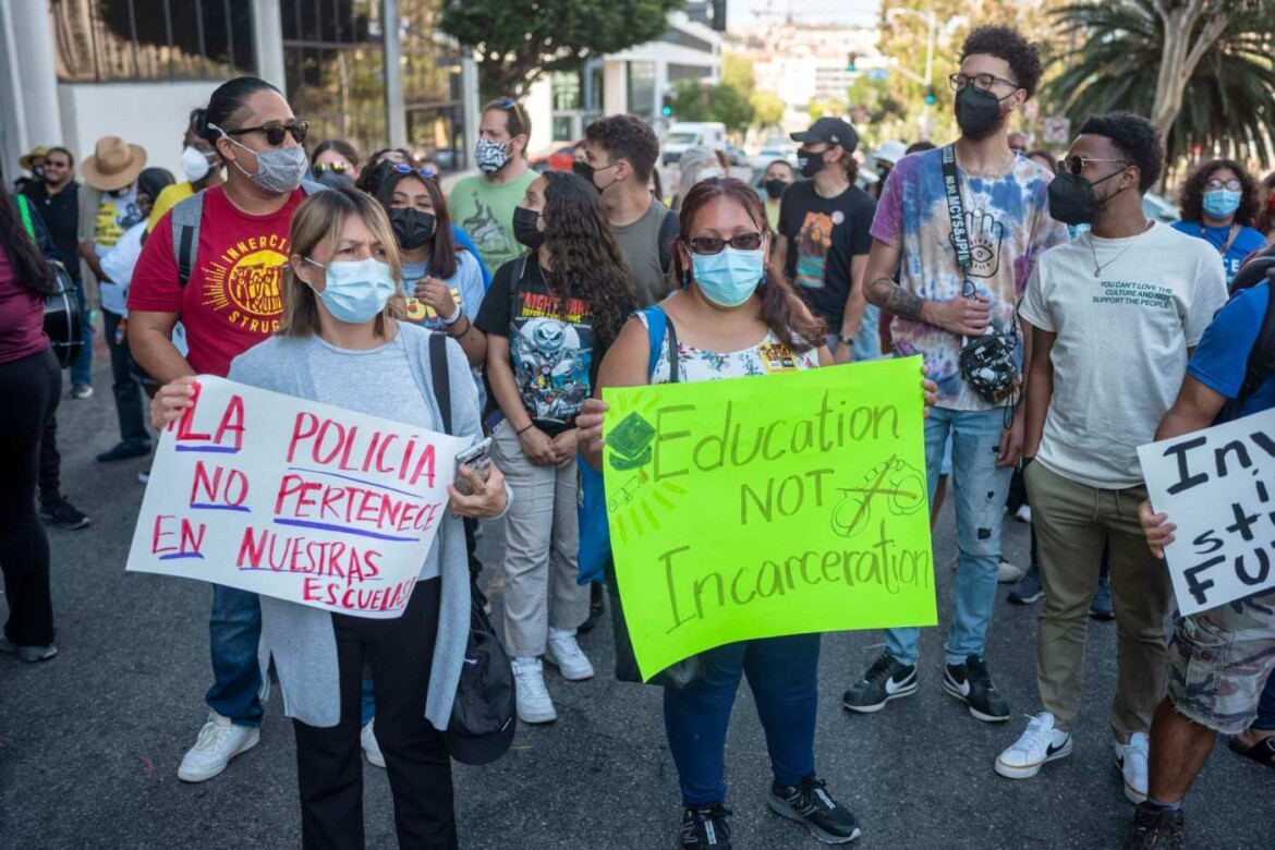 Rallying outside meeting, students, community members urge LAUSD board to defund school police
