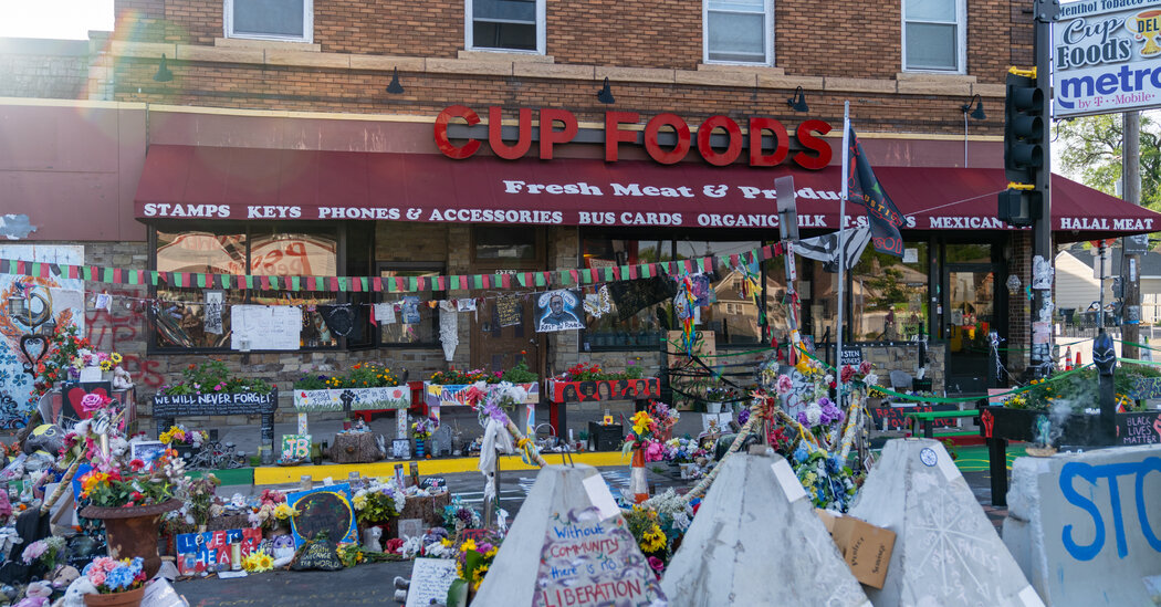 At George Floyd Square, Traffic Now Mixes With Memorials