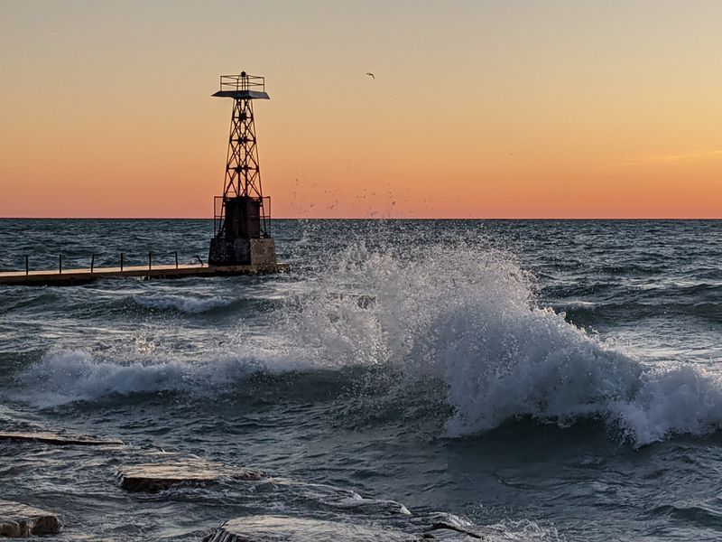 Waves crashing around Foster Avenue Pieron Wednesday, reopening day for perch fishing. Credit: Dale Bowman