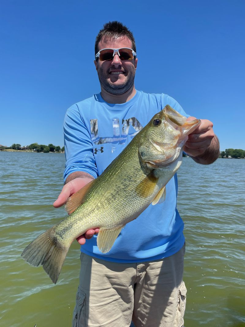 Matt McNamara, of Orland Park, holds one of several nice bass he caught on a Senko with guide Mike Norris. Provided photo