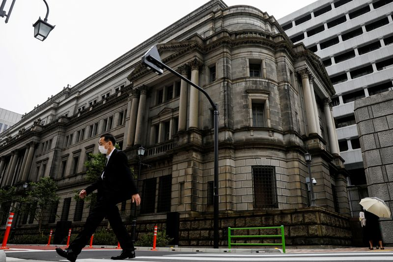 BOJ cuts this year's growth forecast, unveils outline of climate scheme