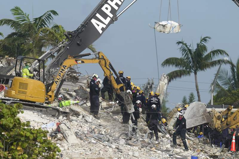 Demolition boosts search at condo, but storms pose threat