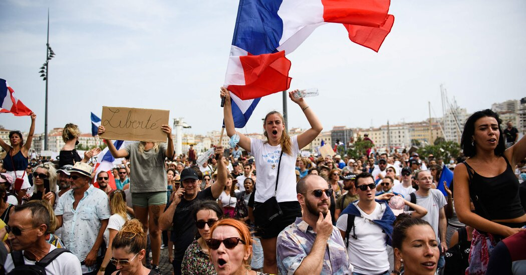 France approves a contentious law making health passes mandatory.