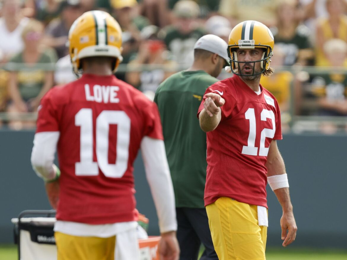 Aaron Rodgers returns to Packers training camp, says some issues remain unresolved