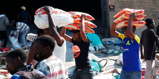 South African looting 'orchestrated,' police minister says
