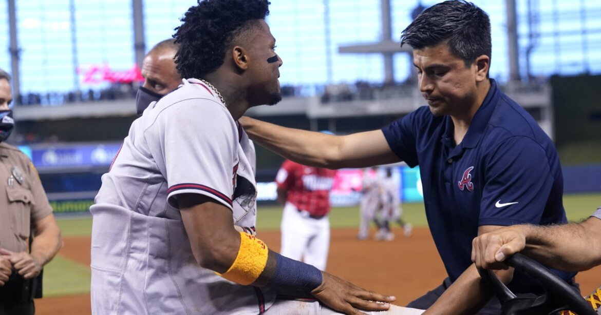 Atlanta Braves' Ronald Acuna Jr. carted off in tears with injured right knee