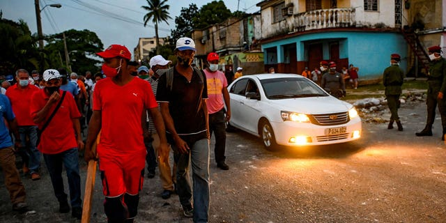 Cuban regime supporters seen brandishing large clubs as protest crackdown continues