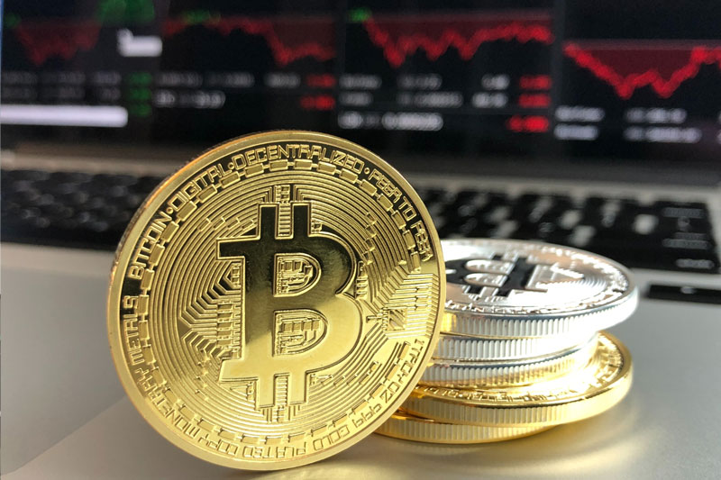 Bitcoin Surge, China Tech Onslaught, Tesla Earnings  – What's Moving Markets