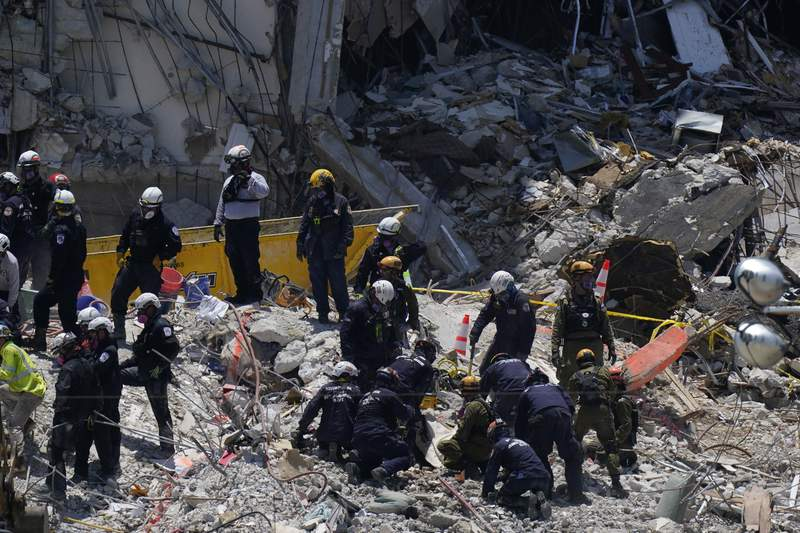 Number of missing in collapse drops; nearby tower evacuated