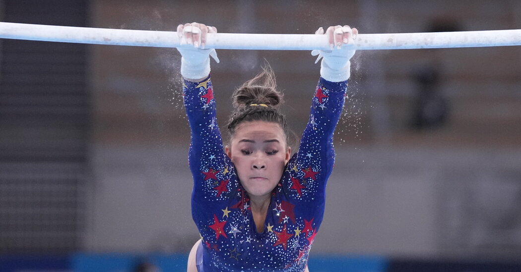 Gymnastics Questions: Here's Why Gymnasts Use Chalk and Grips on the Uneven Bars