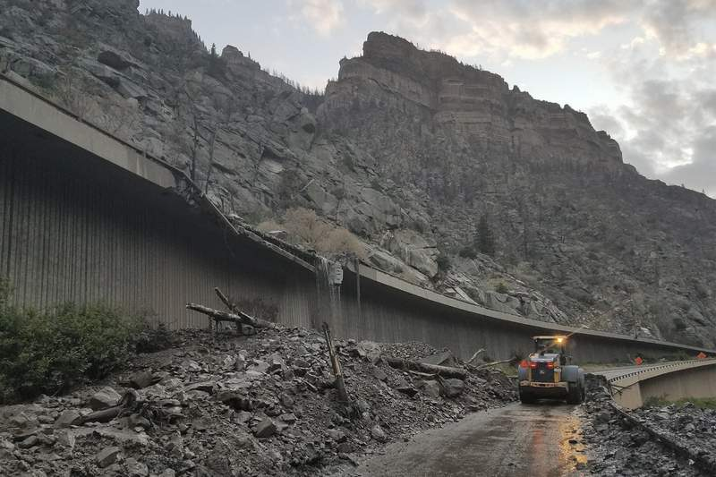 Mudslides force more than 100 to spend night on highway