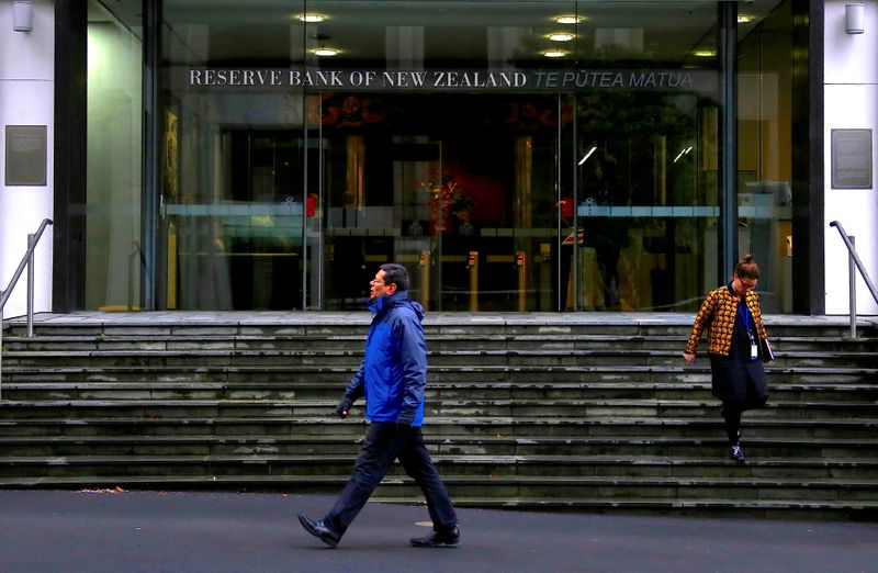 New Zealand central bank surprises by reducing stimulus, Kiwi dollar jumps