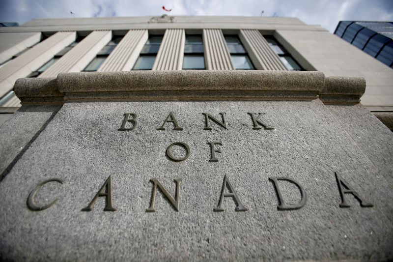 Bank of Canada holds interest rate, says it will curb bond purchases