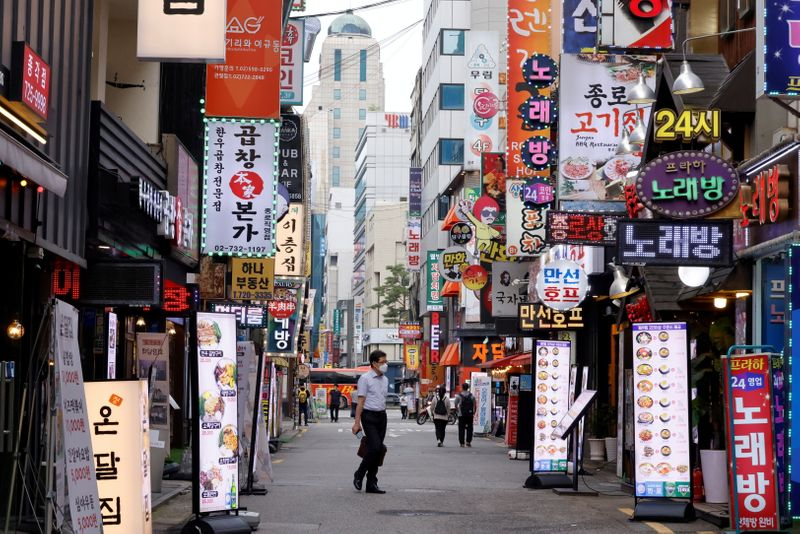 South Korea central bank holds rates as COVID-19 surge clouds tightening plans