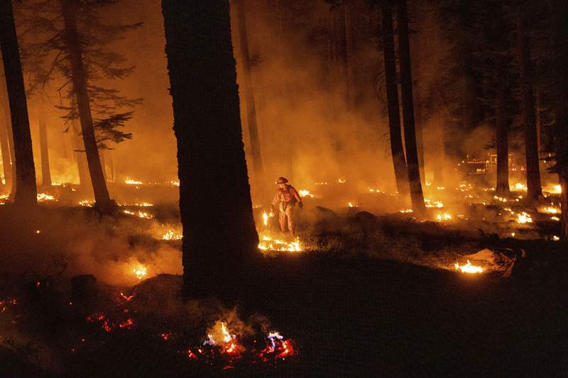 California wildfire flares but within line crews have built