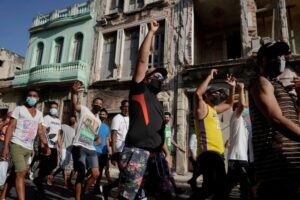 Analysis-Street protests could pressure Cuba to speed up economic reforms