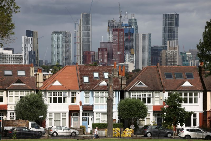 UK households rein in borrowing in July, repay mortgages