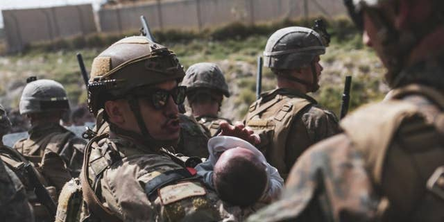 Infants, children being rescued in Afghanistan seen in gripping photos