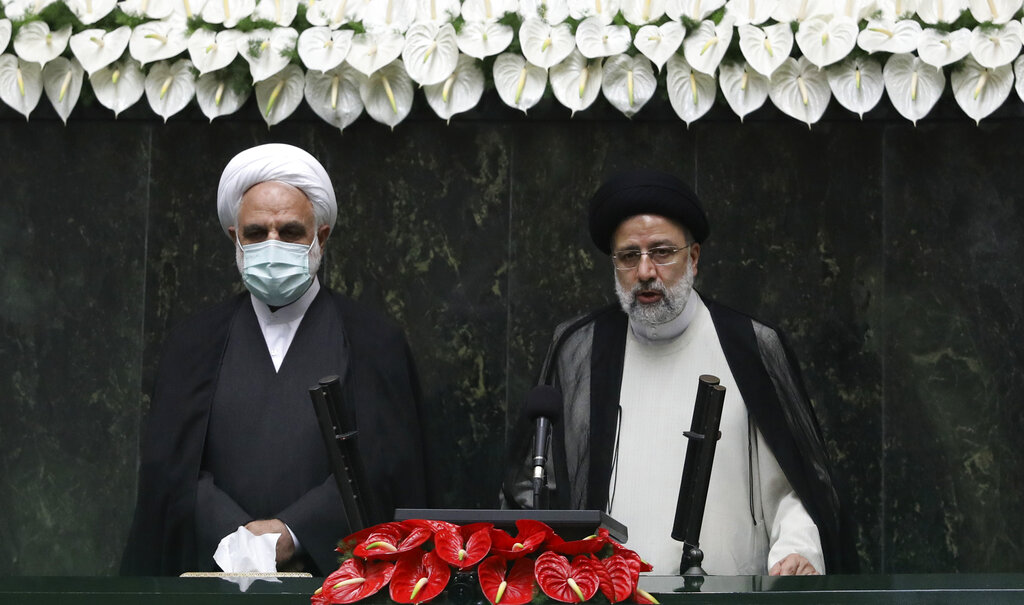 Iranian hardliner Raisi, tied to mass executions, sworn in as regime president