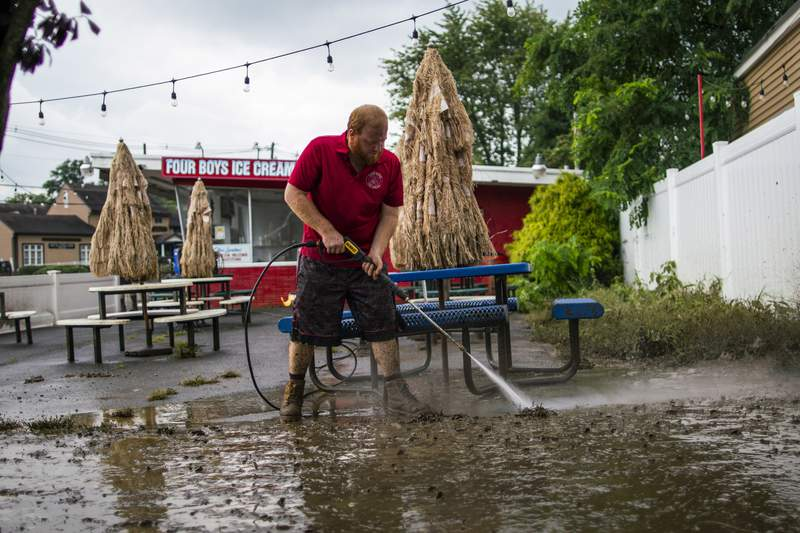 Cleanup begins in soggy Northeast as Henri plods back to sea
