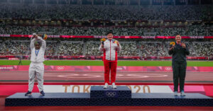 Olympics officials are still negotiating a response to a U.S. podium protest.