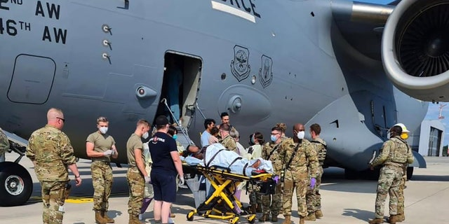 US airmen help pregnant Afghan mother deliver baby aboard Air Force C-17 evacuation flight