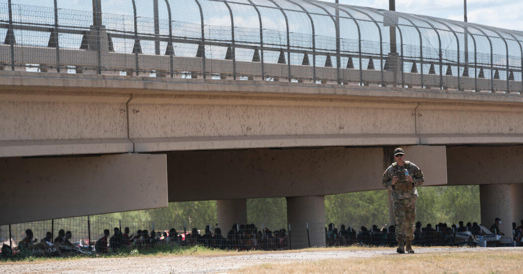 Thousands of Migrants Huddle in Squalid Conditions Under Texas Bridge