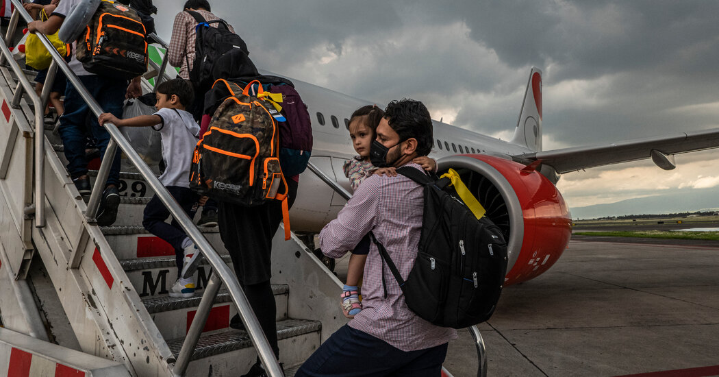 Afghans Who Worked for The New York Times Arrive in Houston